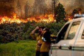 Wildfires rage in western states